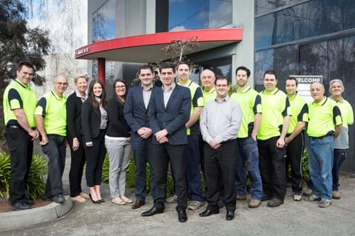 Corporate Portrait Photography | Melbourne Photography | Group staff image outside business building