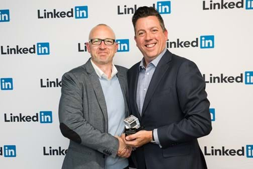 Corporate Event Photography | Melbourne Photography | Man receiving award against brand background