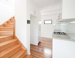 Commercial Photography | Melbourne Photography | Interior image of apartment kitchen and stairs